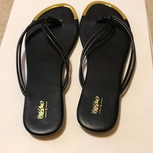 Mossimo Supply Co. Shoes - Mossimo Black and gold flip flops